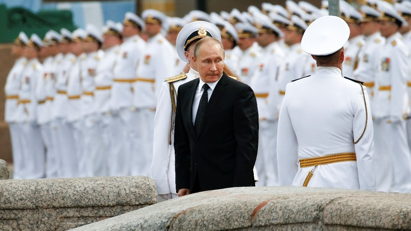 INSIGHT: Putin reviews fleet at Navy Day parade