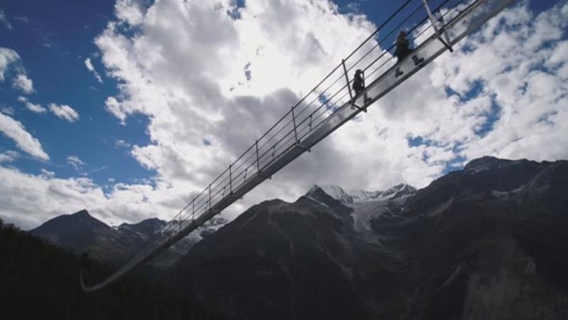 INSIGHT: World's longest suspension bridge opens