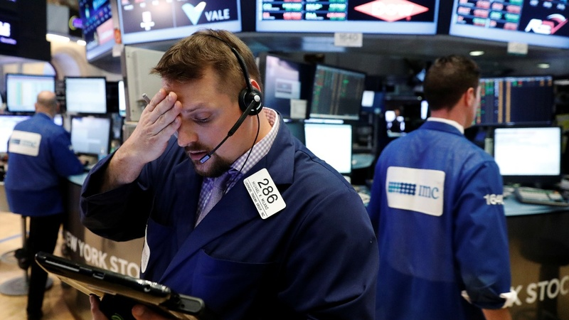 Dow hits record high, but warning signs persist