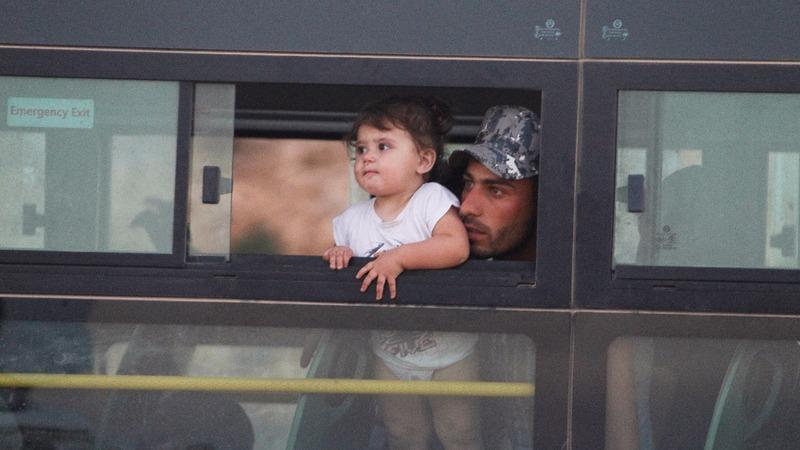 Syrians evacuate Lebanese border camps