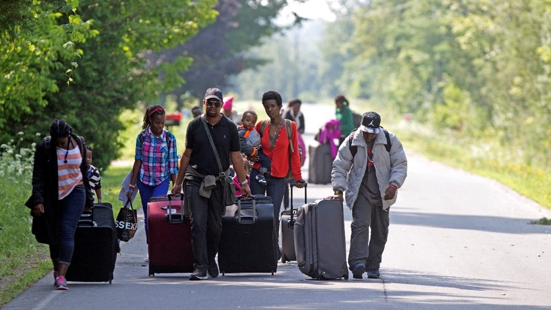Hundreds of Haitians fleeing U.S. for Canada