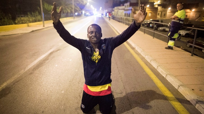 Migrants rush border gate into Spain's Ceuta