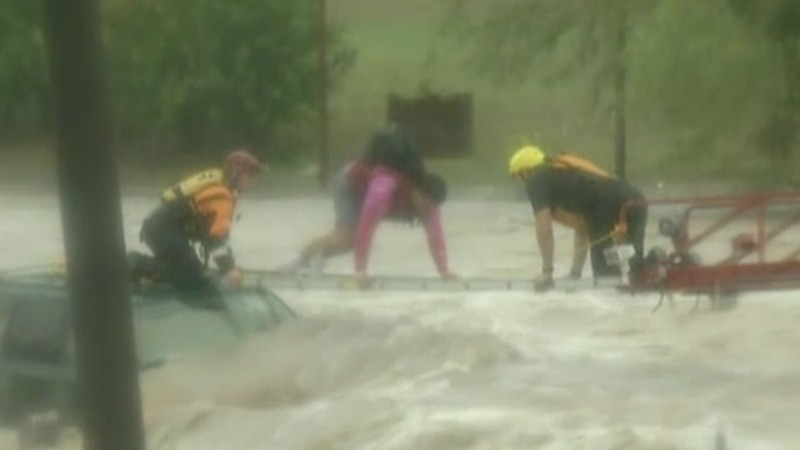 INSIGHT: Treacherous flood rescue for Texas motorist