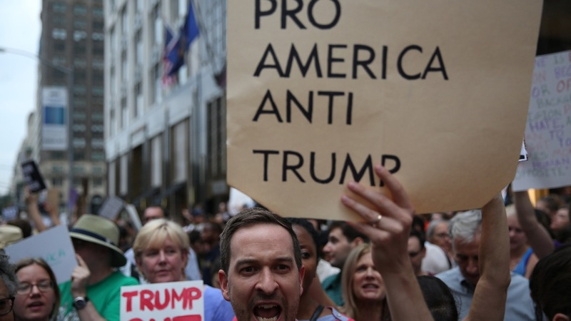 Trump yields to pressure on hate groups, outcry persists