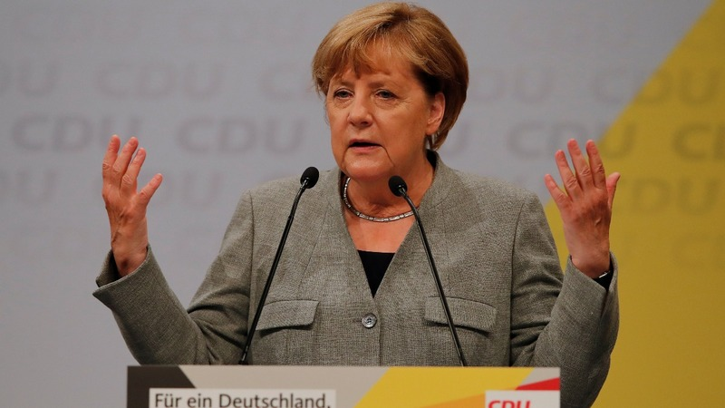 Merkel booed over immigration on re-election trail