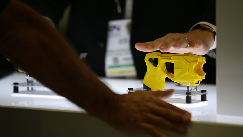 As Taser warns of more risks, cities bear burden in court