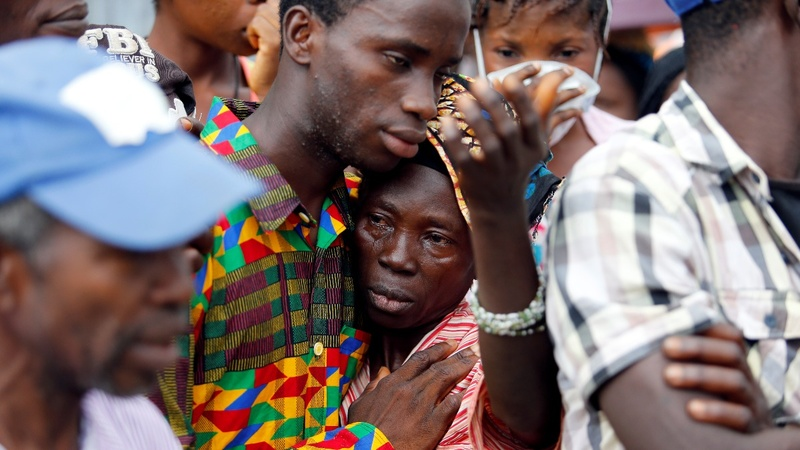 Sierra Leone's race against disease to bury its dead