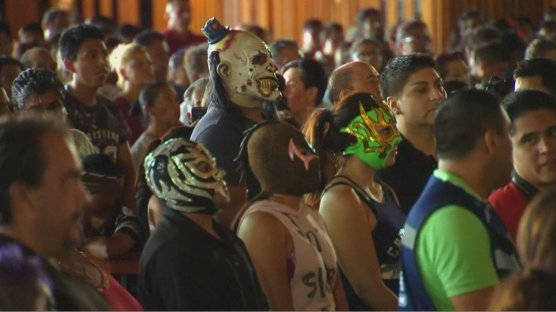 INSIGHT: Masked Mexican wrestlers partake in pilgrimage