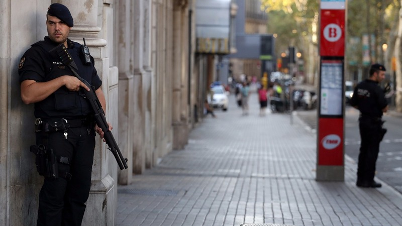Spanish police shoot 5 suspects dead as manhunt continues