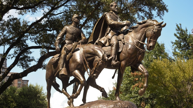 Pro-slavery statues come down, rebuking Trump