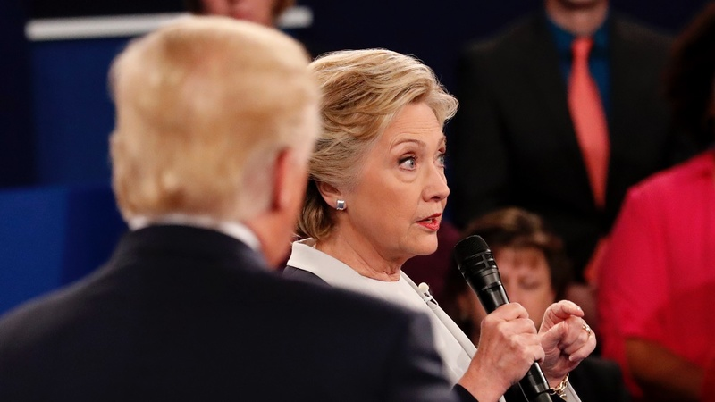 Clinton, in book, says Trump made her 'skin crawl'