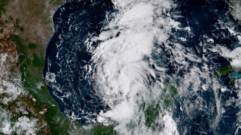 Harvey strengthens into hurricane