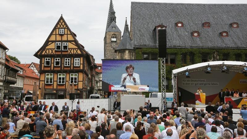 No Regrets: Merkel defiant in face of jeers