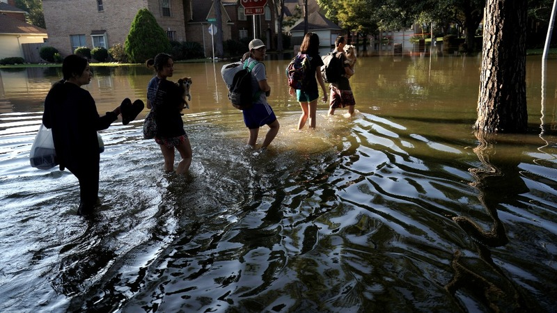 Houston residents return home as flood waters recede