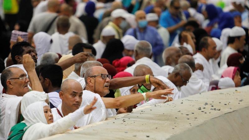 Muslim pilgrims symbolically stone the devil
