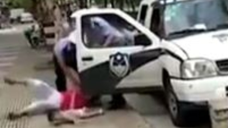China outraged after cop shoves woman and child