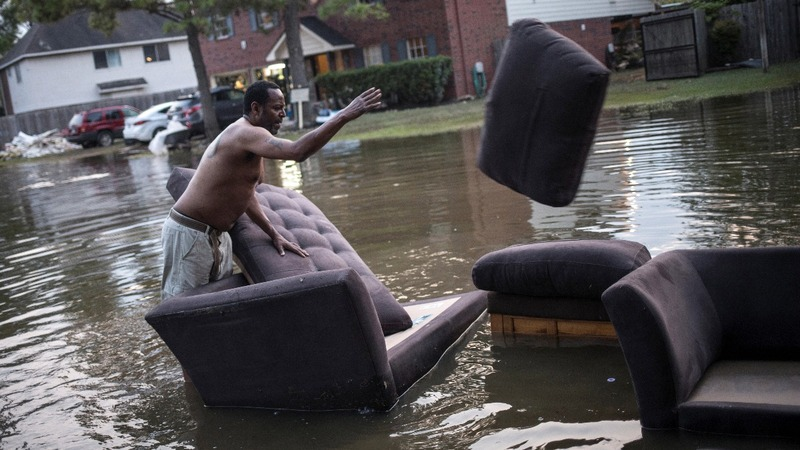 Texans return home as Harvey floodwaters slowly recede