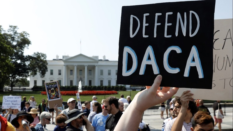 INSIGHT: Protesters blast Trump's plan to scrap DACA