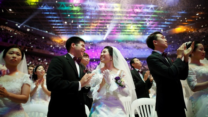 INSIGHT: Thousands tie knot in Seoul mass wedding