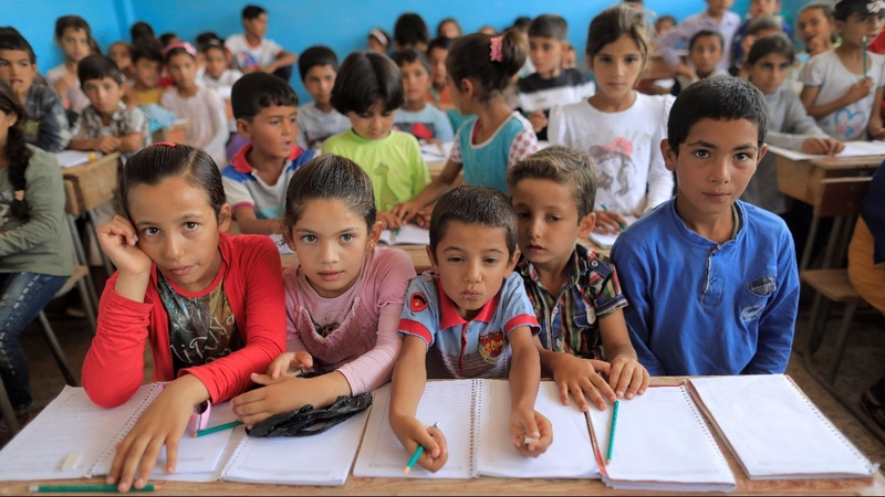 Syrian schools in Raqqa erase Assad