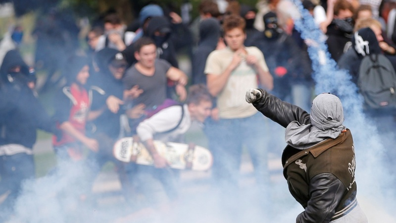 Violent protests mark Macron's first big test