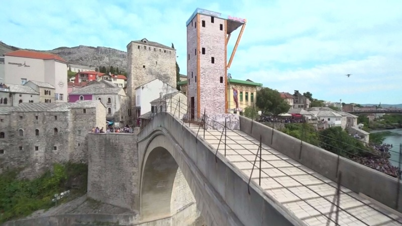 INSIGHT: Cliff diving championship on historic bridge