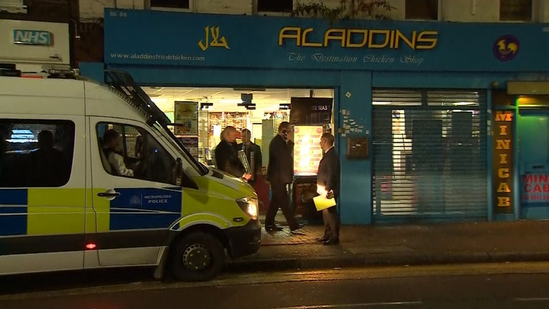 Police raid London takeaway after train bomb