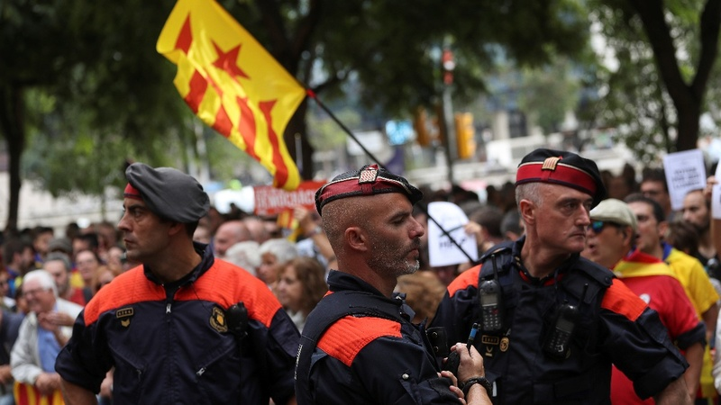 Madrid takes over local police force in Catalonia