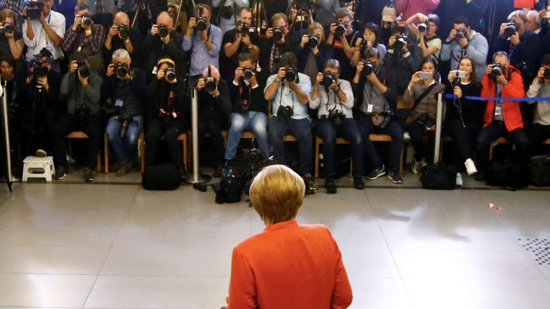 Merkel clinches German victory, but far-right rise