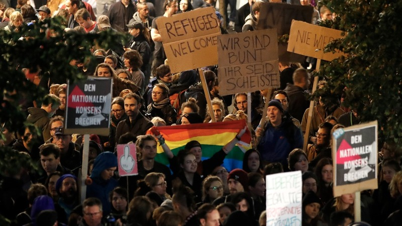 Amid protests, AfD pledge to 'hound' Merkel