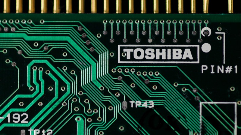 Toshiba sells its $18 billion computer chip unit, but...