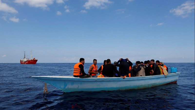 Libyans flee by boat amid 'terrible' violence