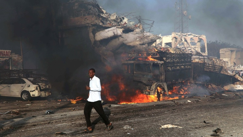 Dual car bombs kill at least 22 in Somalia's capital