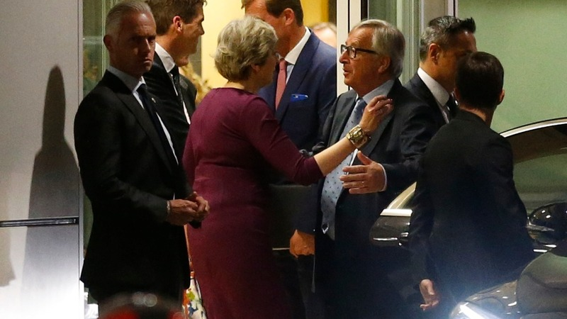 May, Juncker call for faster Brexit talks