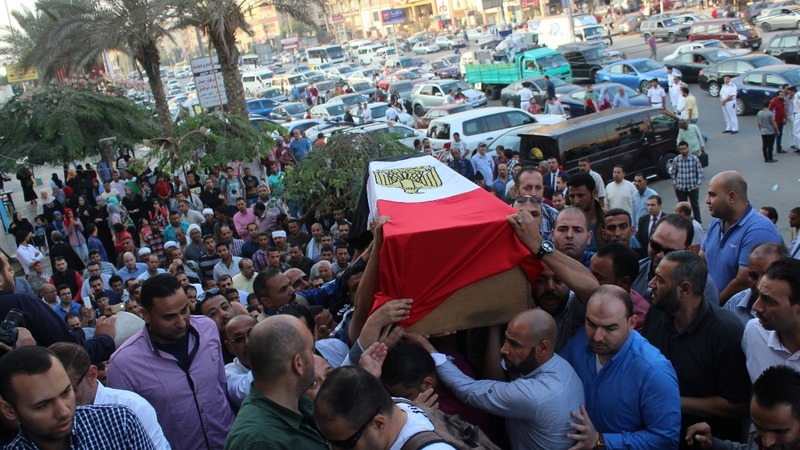 Mourners farewell to Egyptian police killed in shootout