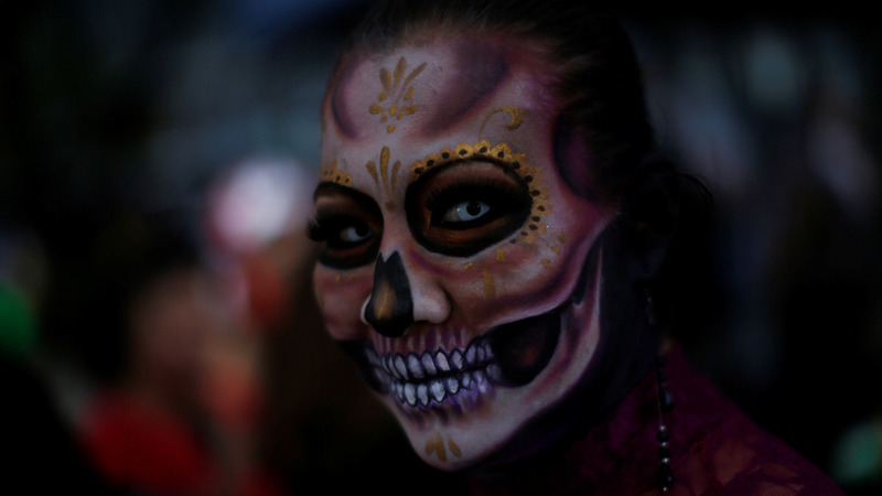 INSIGHT: Skeletons adorn Mexican streets ahead of Day of the Dead