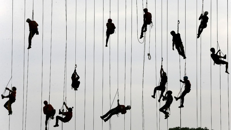 INSIGHT: Hundreds of Brazilians jump off a bridge