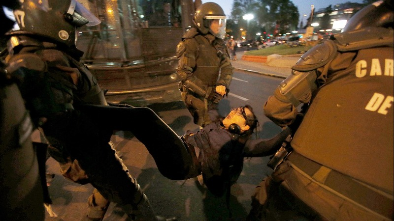 INSIGHT: Chilean student protesters clash with police