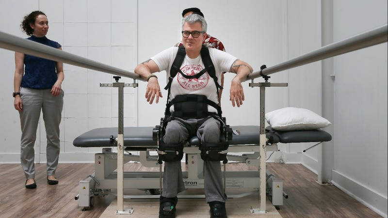 Rising with machines: an exoskeleton meets paralysis