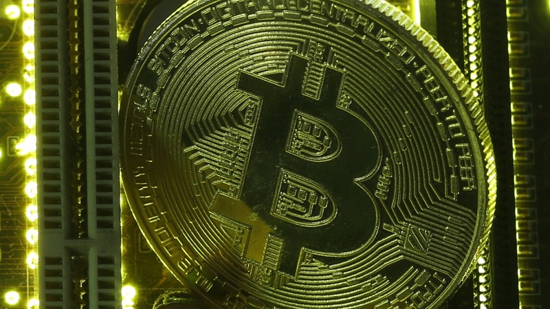 Poised to enter mainstream, Bitcoin blasts to record high