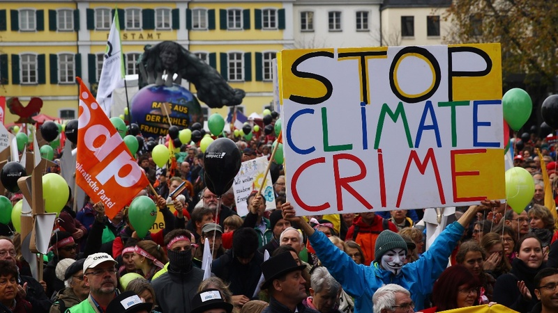 INSIGHT: Thousands attend climate protest ahead of Bonn conference