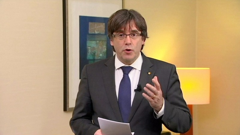 Ex-leader Puigdemont hands himself in to police