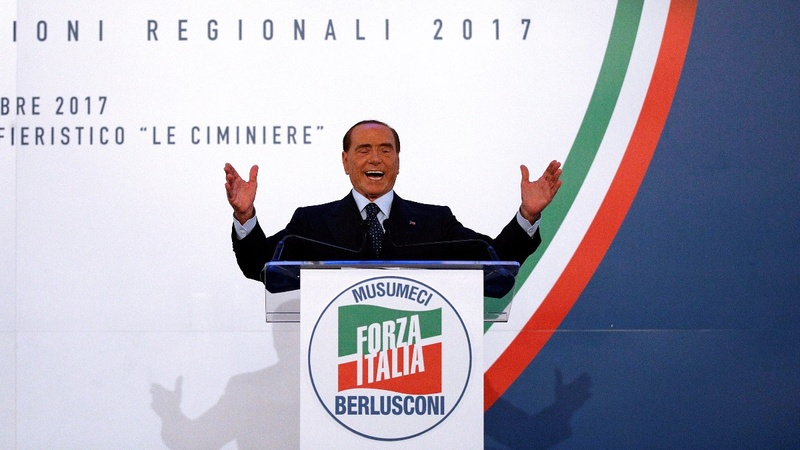 Italy's Berlusconi re-enters politics with a bang