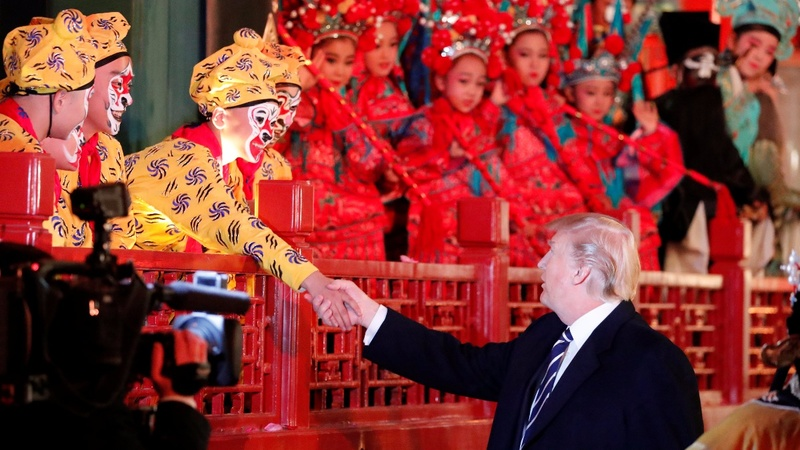 Trump touches down for top-level talks with China's Xi