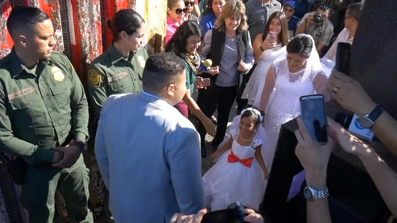 INSIGHT: U.S. briefly opens Mexico border fence for wedding