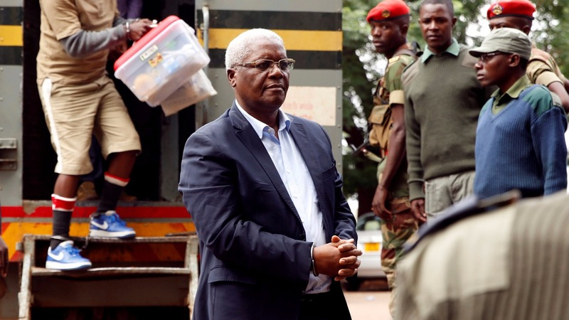 Zimbabwe's ousted minister at court in handcuffs