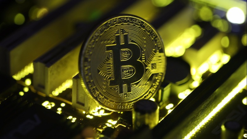 Bitcoin tops $11,000, reaching new record high