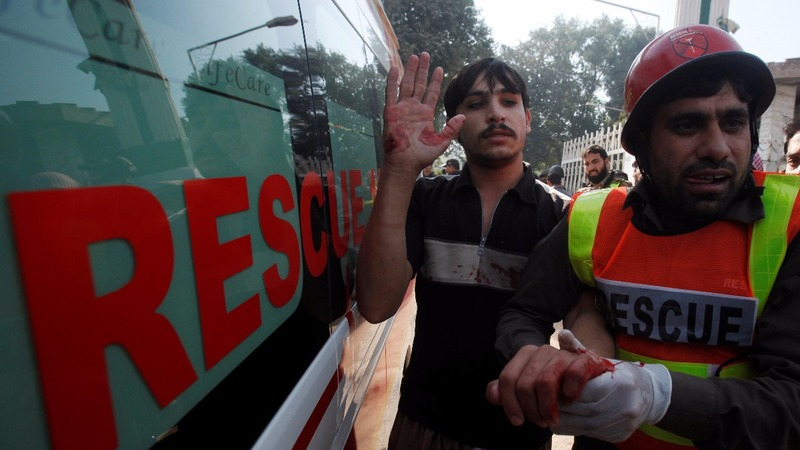 Gunmen in burqas kill nine at Pakistan college