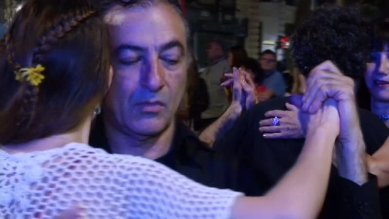 INSIGHT: Argentines take to the streets with Tango