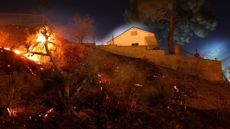 California wildfires roar through residential neighborhoods